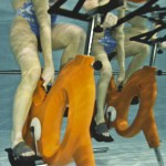 Aquabike arancione in piscina